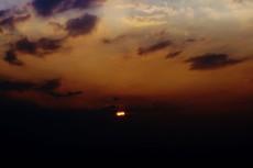 空と落日の写真素材