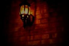 レンガの壁と照明の写真素材